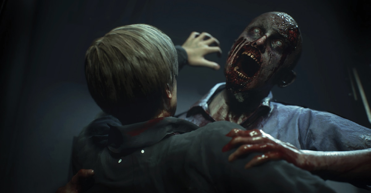 A zombie lunges at Leon Kennedy from Resident Evil 2